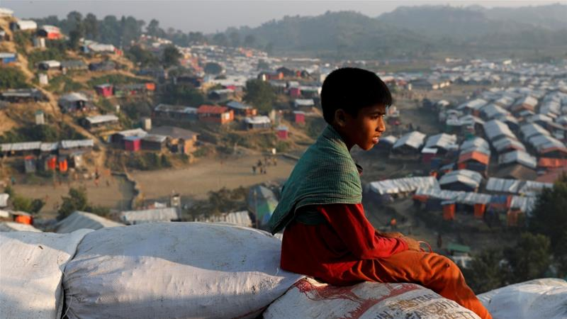 A Rohingya refugee child looks at the Unchiparang refugee camp from a hill, near Cox's Bazar, Bangladesh on January 11, 2018 [Tyrone Siul/Reuters]