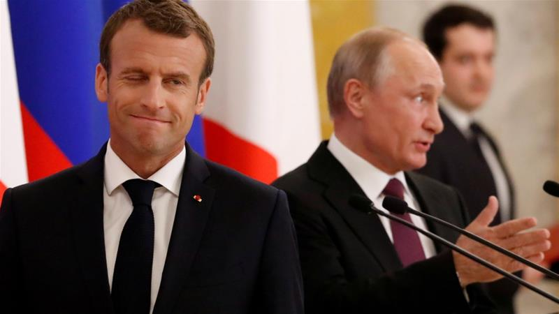 Russian President Vladimir Putin and his French counterpart Emmanuel Macron attend a news briefing after the talks in St Petersburg, Russia on May 24, 2018 [Grigory Dukor/Reuters]