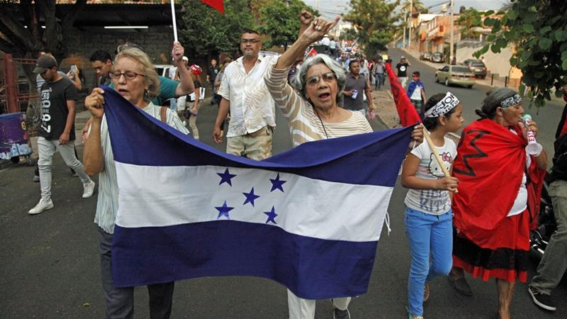 Opposition members in Honduras protested against the US decision on migrants [Fernando Antonio/The Associated Press]