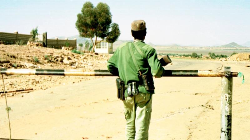 An Eritrean soldier looks across the closed border towards Ethiopia from his post in Serha, Eritria [AP]