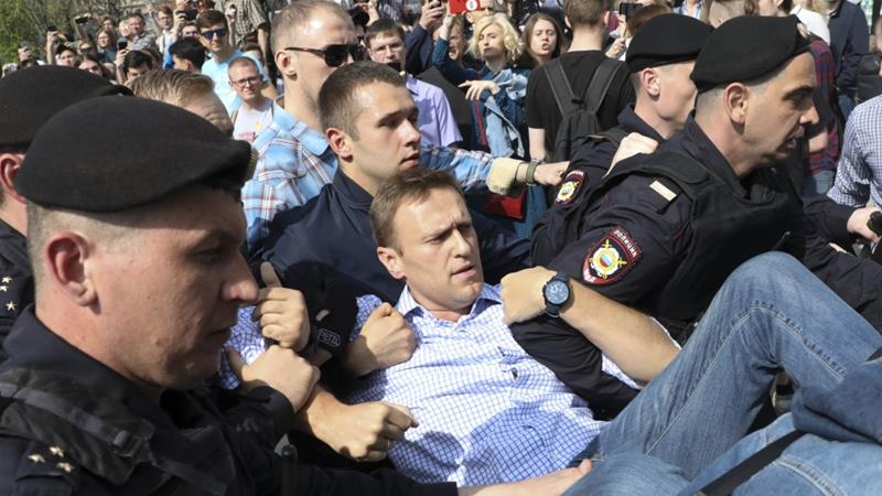 Russian police arrest opposition leader Alexei Navalny at a demonstration against President Vladimir Putin in Pushkin Square in Moscow on May 5, 2018 [AP]