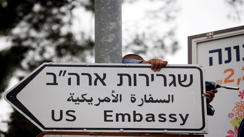 'US Embassy' road signs in English, Hebrew and Arabic were installed in Jerusalem on Monday [Ronen Zvulun/Reuters]