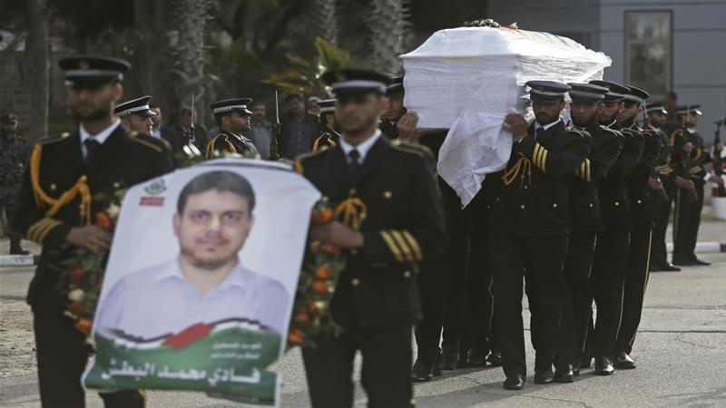 Hamas' honour guard carried the coffin of Fadi al-Batsh after it was delivered to the Gaza Strip [Khalil Hamra/The Associated Press]