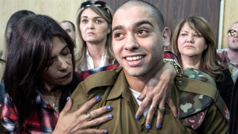Israeli soldier Elor Azaria, shown with his mother here, was filmed shooting dead a Palestinian in Hebron in 2016 [Reuters]