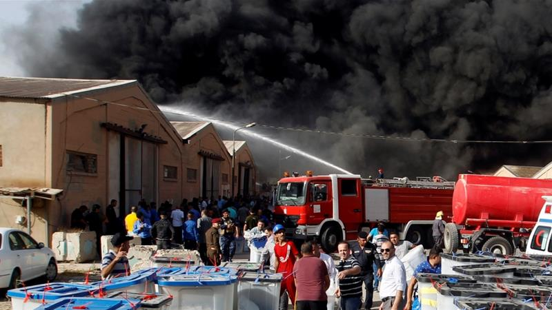 Ballot box blaze: Baghdad's largest voting warehouse goes up in flames