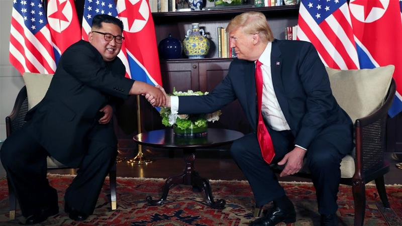 Trump shook hands with Kim before their meeting at the Capella Hotel in Singapore [Jonathan Ernst/Reuters]