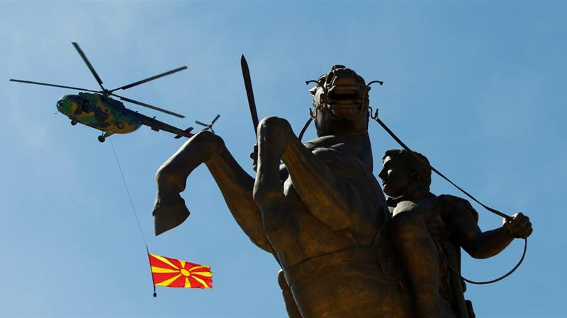 Macedonian Army helicopter flies near the Alexander the Great monument during exercises to mark NATO day in Skopje on April 4, 2018 [Reuters/Ognen Teofilovski]