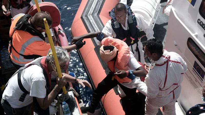 Migrants disembark in Spain after Mediterranean standoff