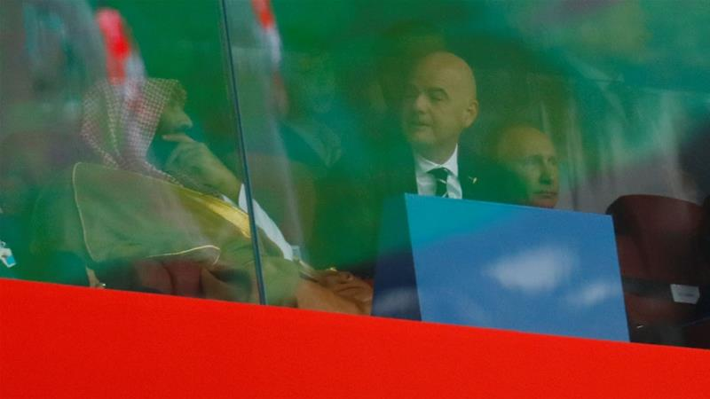 Russian President Vladimir Putin, FIFA President Gianni Infantino and the Saudi crown prince watch the first match of the FIFA 2018 World Cup [Kai Pfaffenbach/Reuters]