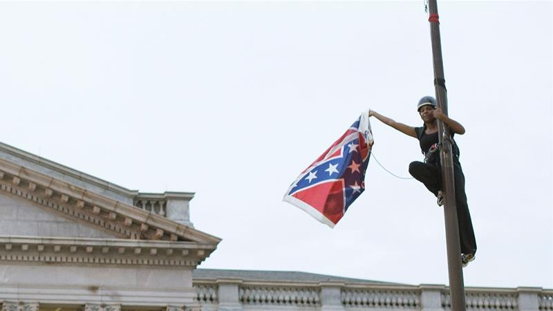 Brittany 'Bree' Newsome removes the Confederate flag from a pole at the Statehouse in Columbia  [File: Adam Anderson/Reuters]