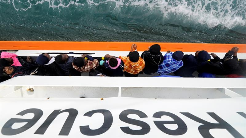 Migrants wait to disembark from the Aquarius rescue ship in the Sicilian harbour of Catania in Italy on May 27, 2018 [Guglielmo Mangiapane/Reuters]