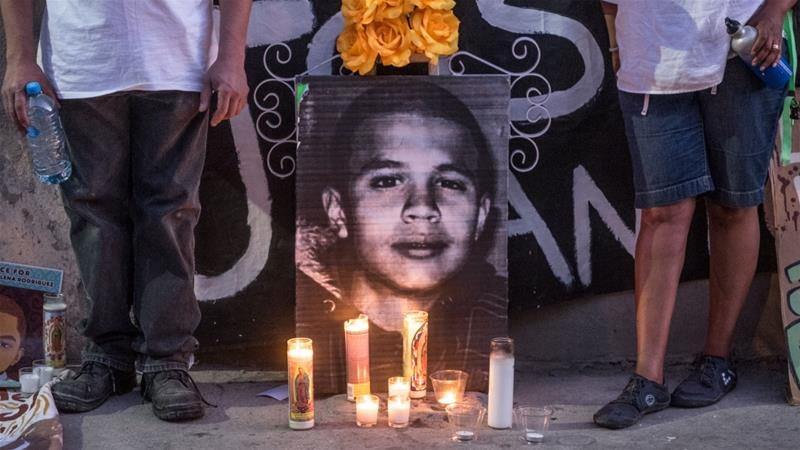 Candles and a picture of Jose Rodriguez is seen during a vigil for the teen [Eline van Nes/Al Jazeera]