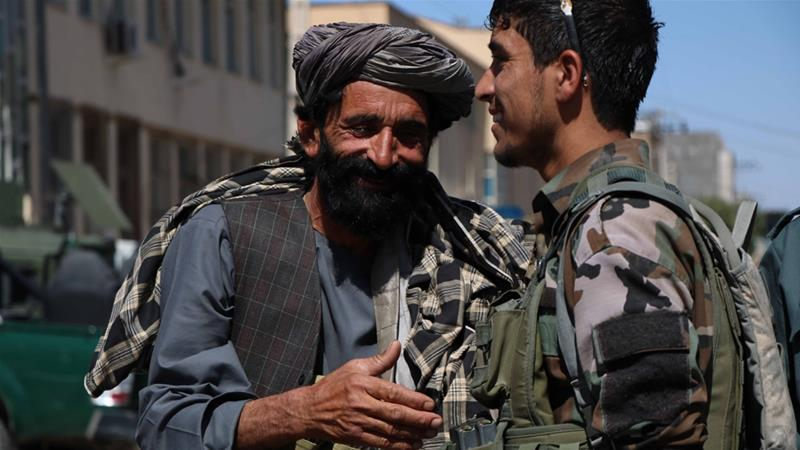 Taliban fighters shook hands with Afghan soldiers in Herat during the ceasefire [Jalil Rezayee/Reuters]