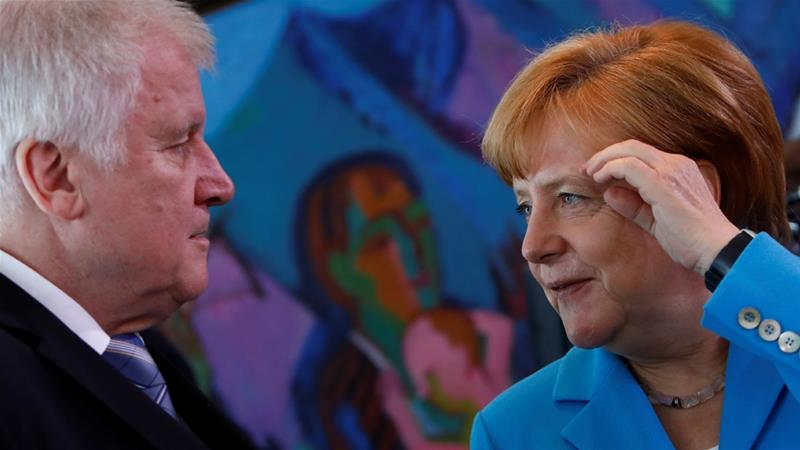 Seehofer on Monday agreed to implement his immigration 'master plan' step by step [File: Michele Tantussi/Reuters]