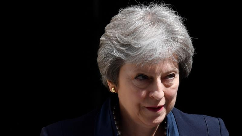 May has been under pressure from opposition MPs to condemn the policy [File:Toby Melville/Reuters]
