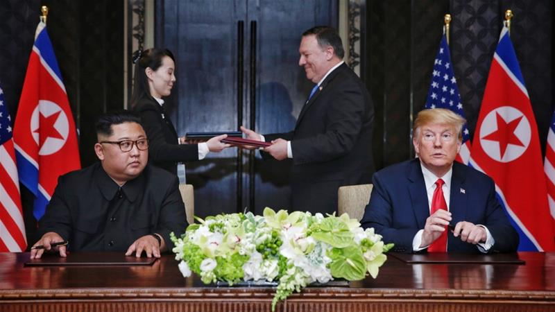 US President Donald Trump and North Korea's leader Kim Jong-un participate in a signing ceremony as part of the US-North Korea summit  in Singapore on June 12, 2018 [Anadolu]