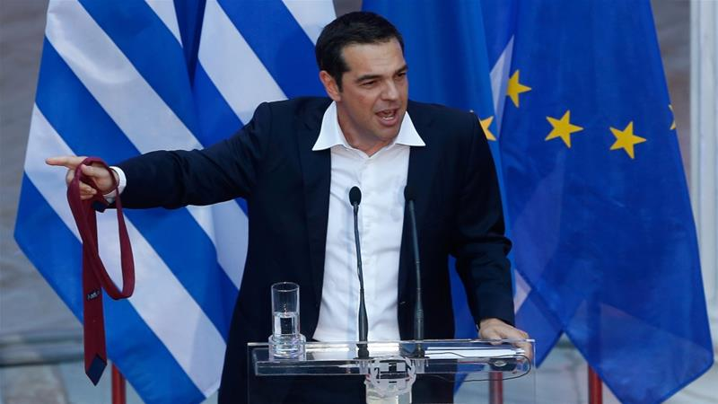 Greek Prime Minister Alexis Tsipras holds his tie as he speaks at the parliamentary group of Syriza and Independent Greeks in Athens, Greece on June 22, 2018 [Costas Baltas/Reuters]