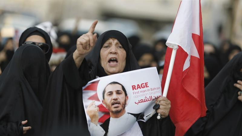 A woman holds a placard with an image of Sheikh Ali Salman during a demonstration against his persecution in Bilad Al Qadeem, south of Manama, Bahrain on December 29, 2014 [Hamad I Mohammed/Reuters]