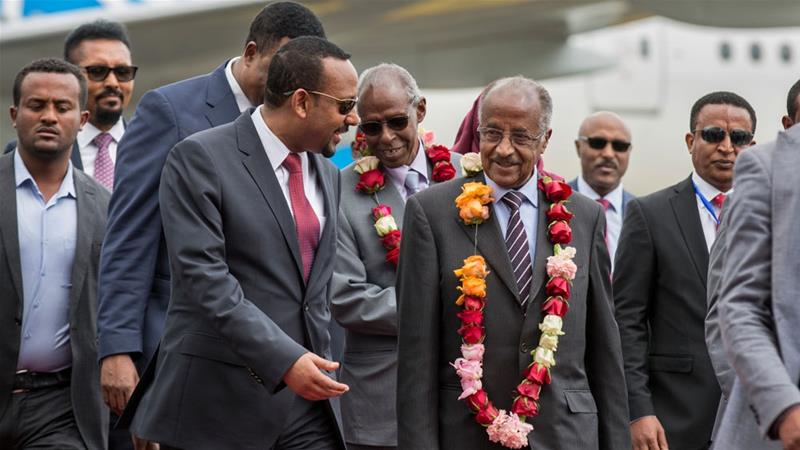 Eritrea's foreign minister (R) is welcomed by Ethiopia's prime minister (L) in Addis Ababa [Mulugeta Ayene/AP]