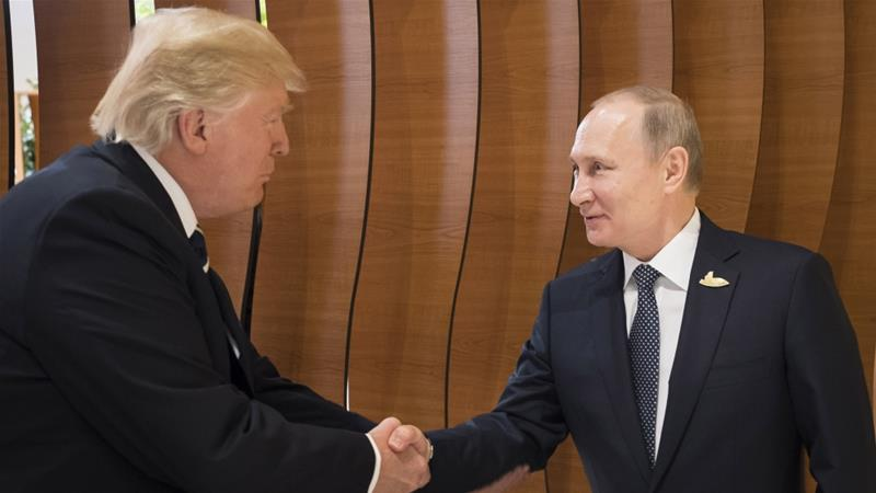 The summit between US President Trump and Russian President Putin will take place in a mutually convenient third country [File: Steffen Kugler/Getty Images]