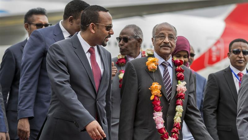 Eritrea's Osman Sale was welcomed by Ethiopia's Abiy Ahmed at the airport in Addis Ababa on June 26 [Mulugeta Ayene/AP]