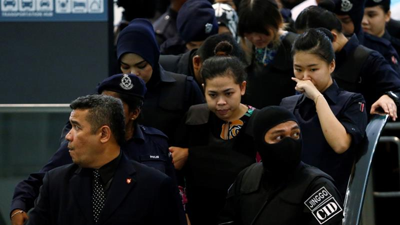 Indonesian Siti Aisyah and Vietnamese Doan Thi Huong are escorted as they revisit the Kuala Lumpur International Airport 2 in Sepang, Malaysia October 24, 2017. REUTERS/Lai Seng Sin [Reuters]