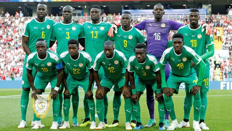 Senegal players pose for a team group photo before their match with Poland on June 19, 2018 [Reuters/Christian Hartmann]