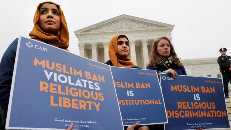 Protesters gather outside the US Supreme Court to rally against President Donald Trump's latest travel ban affecting people from Muslim-majority countries [File: Yuri Gripas/Reuters]