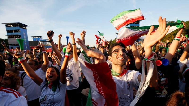 Supporters of Iran celebrate while watching the match between Iran and Morocco in a fan zone in Moscow, Russia on June 15, 2018 [Gleb Garanich/Reuters]