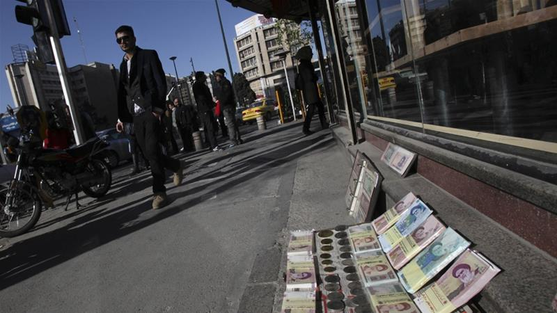 Iran's exchange rate hit 79,000 rials to a US dollar in the black market on Tuesday, up 110 percent from last year [File: AP]