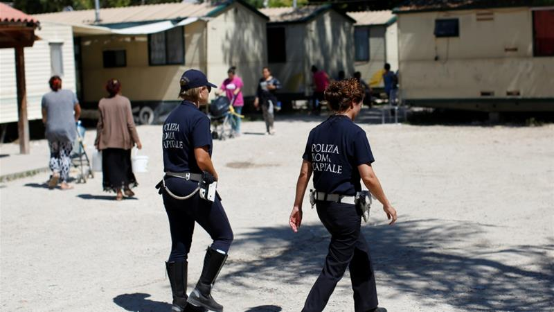 Police clear a Roma camp in the Italian capital [Tony Gentile/Reuters]