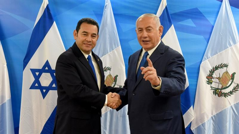 Israeli Prime Minister Benjamin Netanyahu shakes hands with Guatemalan President Jimmy Morales following the dedication ceremony of the embassy of Guatemala in Jerusalem [Debbie Hill/Reuters ]