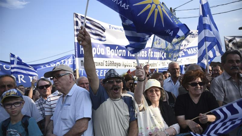 Greeks rally against a name deal between Athens and Skopje [Giannis Papanikos/AP Photo]