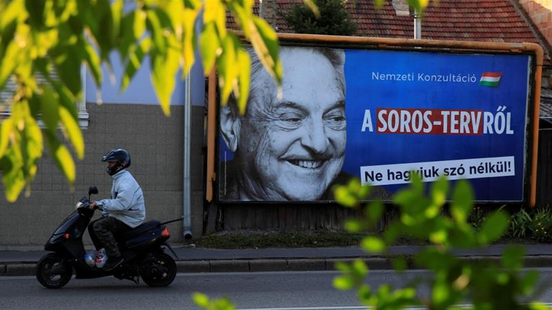A government billboard is seen displaying George Soros in Hungary [File: Bernadett Szabo/Reuters]