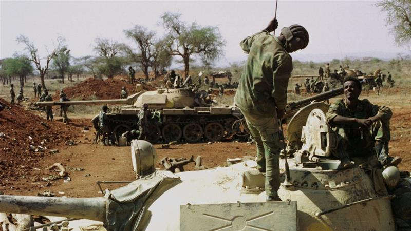 The two-year war between Eritrea and Ethiopia killed an estimated 100,000 people. In this file photo from 1999, Eritrean forces are seen near the Belesse front line, preparing for battle [Reuters]