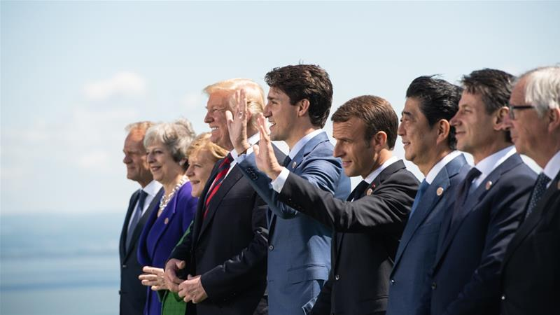 Group photo masks underlying tension at G-7 summit