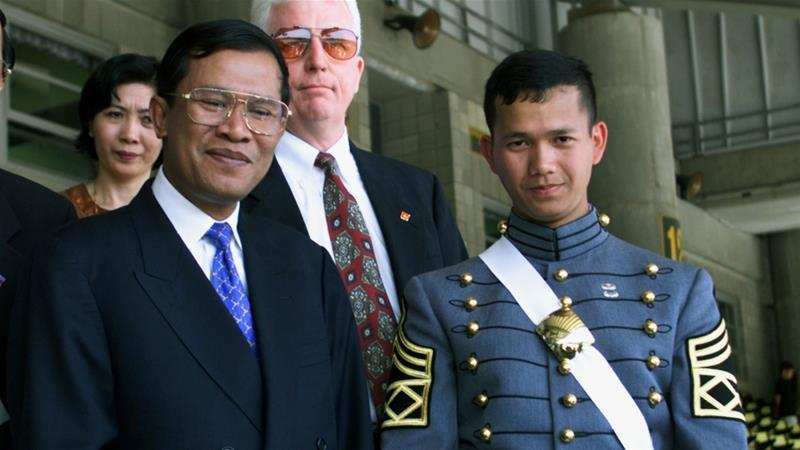 Hun Manet, right, was promoted to acting chief of joint staff and commander of the army headquarters [Jeff Christensen/Reuters]