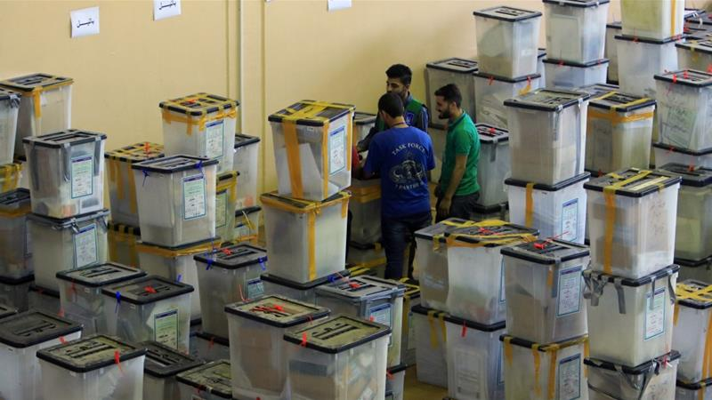 Employees of the Independent High Electoral Commission inspect ballot boxes at a warehouse in Duhok, northern Iraq [File: Ari Jalal/Reuters]