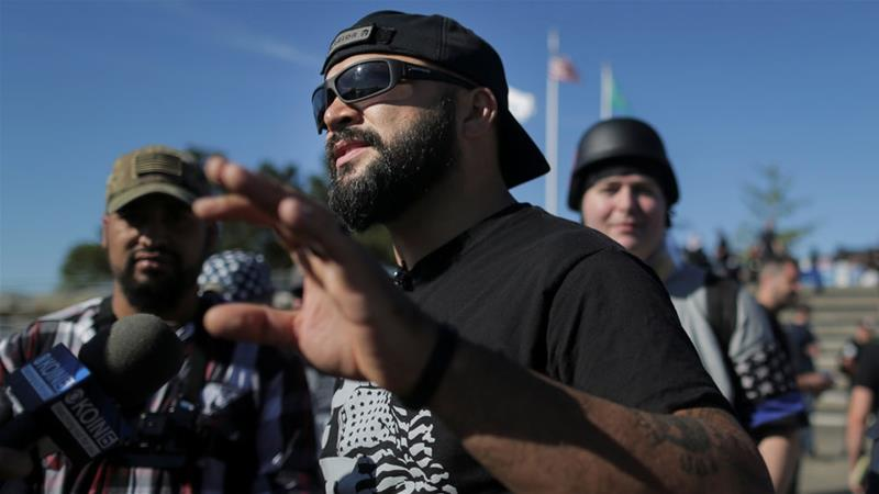 Joey Gibson, founder of the right-wing group Patriot Prayer, speaks to the press following a rally in Washington state last year [File: Elijah Nouvelage/Reuters]