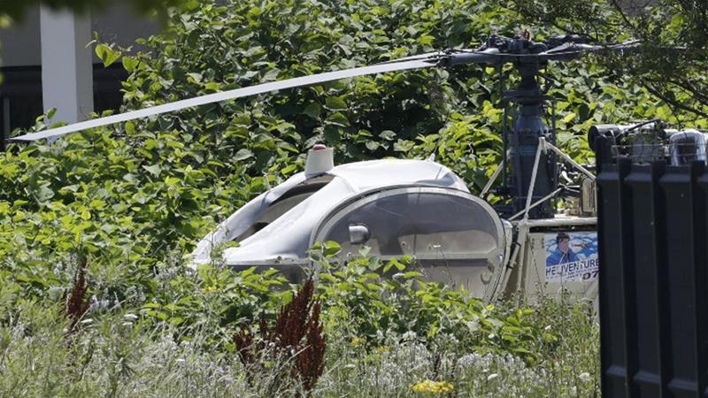The burned-out helicopter used in the escape was found by local police in Gonesse, north of Paris [Geoffroy van der Hasselt/AFP]