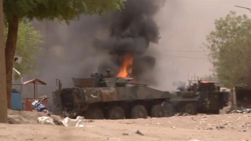 A still image taken from a video shows an armoured personnel carrier on fire after a car bomb attack in Gao [Reuters]