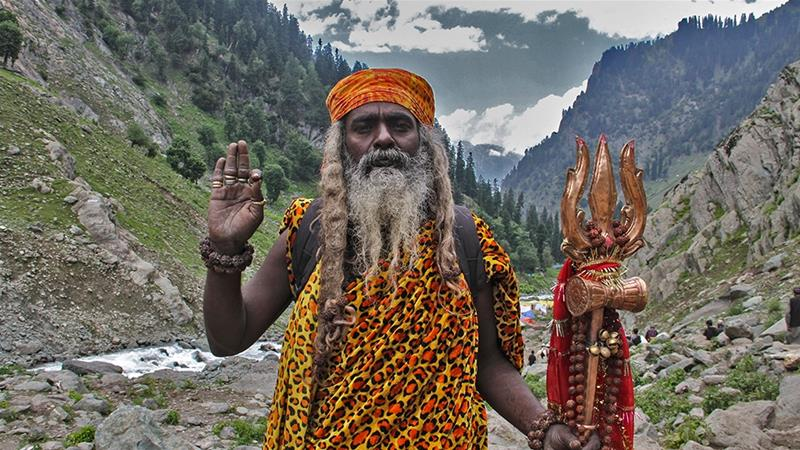 TP Palani Swami pictured returning from the Amarnath cave. He walked for three months from the south Indian state of Chennai for the Amarnath pilgrimage [Sameer Mushtaq/Al Jazeera]