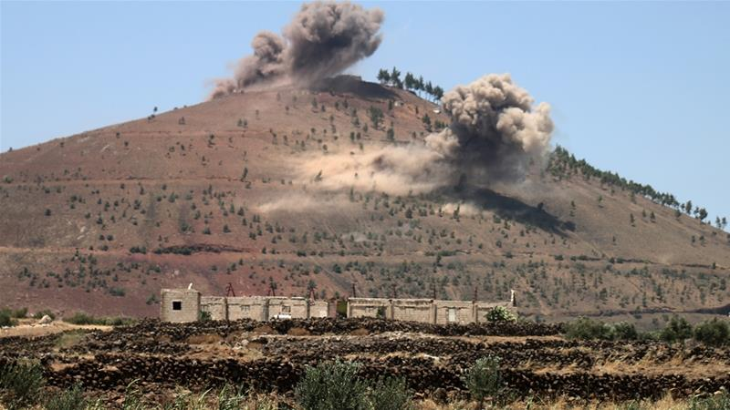 Smoke rises on hills overlooking the southern Quneitra province, during shelling by Syrian forces against rebels [AFP]