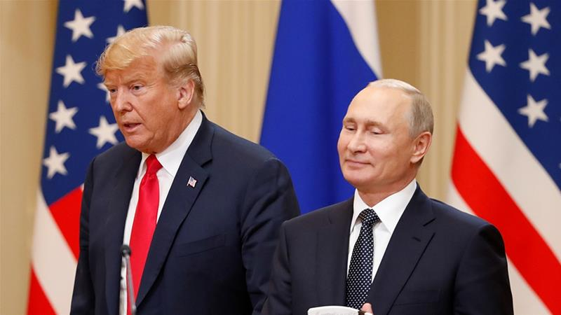 US President Donald Trump and Russian President Vladimir Putin arrive for a joint news conference after their meeting in Helsinki, July  2018 [File: Grigory Dukor/Reuters]
