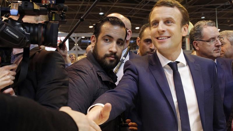 Alexandre Benalla, left, was given a given a 15-day suspension for 'unacceptable' behaviour [Philippe Wojazer/Reuters]