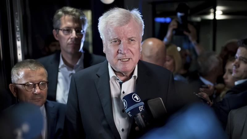 Seehofer confirmed early on Monday morning he would offer to step down [Sven Hoppe/DPA via AP]