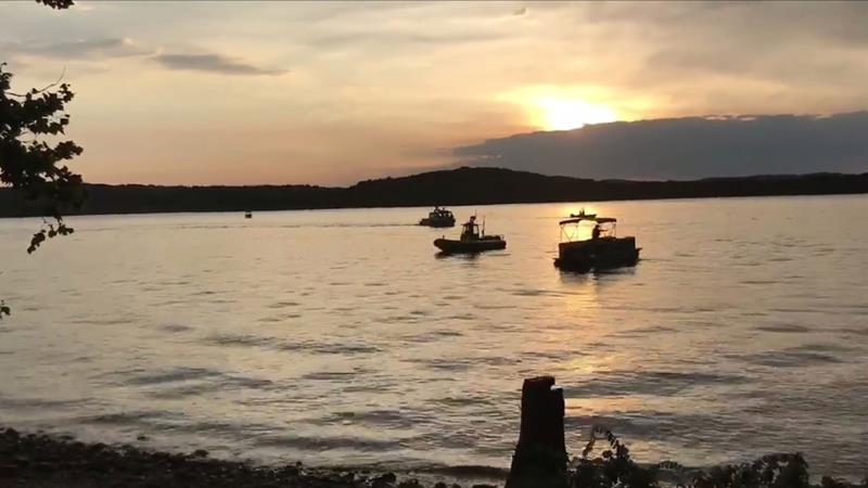 Divers were deployed to search for those still missing after the boat capsized on Thursday evening [Southern Stone County Fire Protection District/EPA]