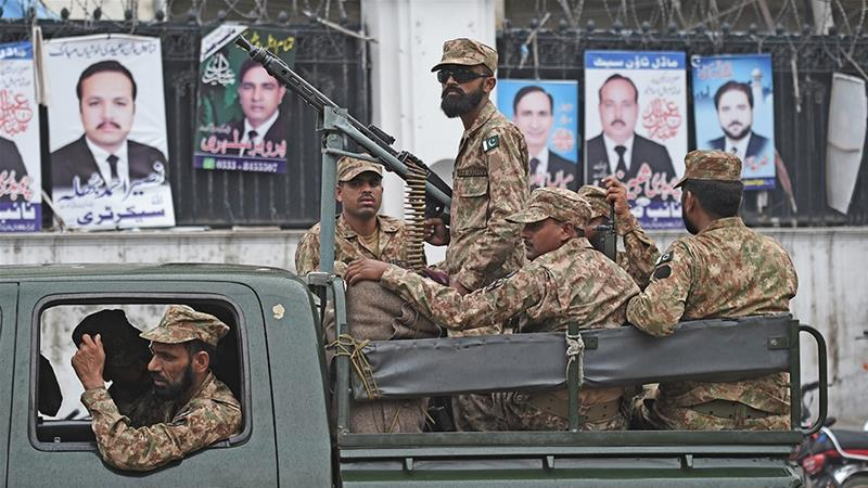 Pakistani soldiers patrol outside a voting material distribution centre in Lahore [Wakil Kohsar/AFP]