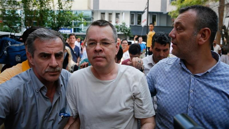 Pastor Brunson, centre, a US citizen, has been imprisoned in Turkey for the last 21 months [Reuters]