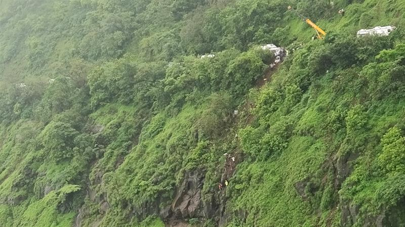 Rescuers work at the site of an accident in Raigad district in the western Indian state of Maharashtra [AP Photo]